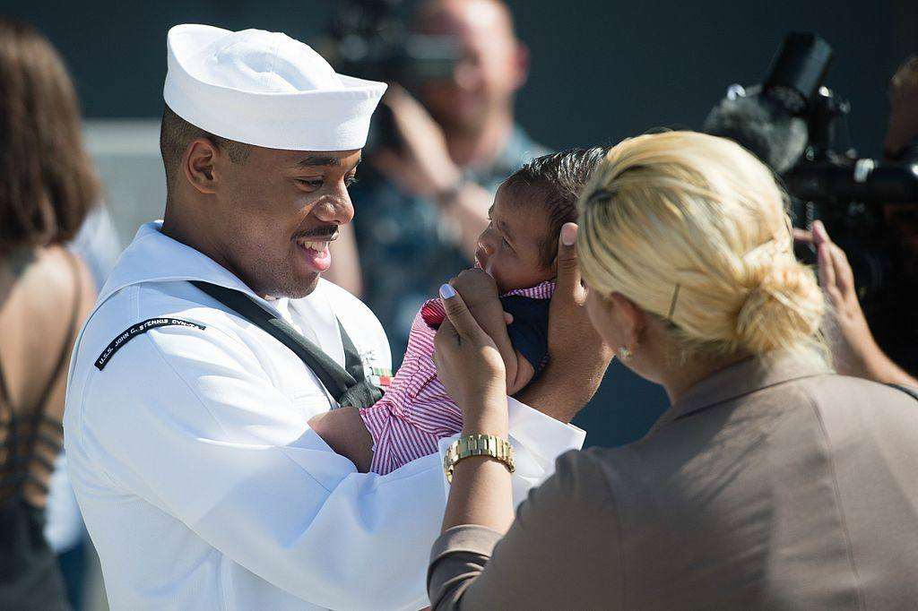 What's the best age to become a dad?, Sailor meets his child for the first time after returning from a seven month deployment%, new-dad, lifestyle, community%