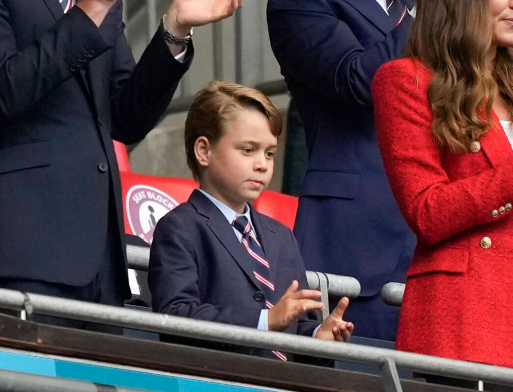 Beaming George celebrates England victory with William and Kate